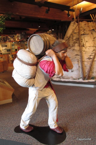 Voyageur carrying his load over the Grand Portage